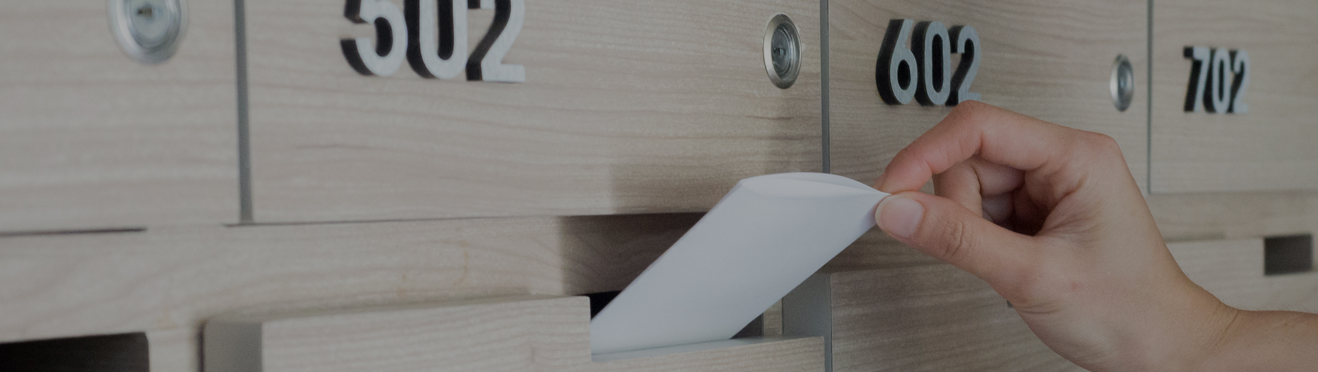 apartment letterbox with a white letter sticking out